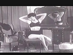 A classic black and white film to a girl doing a reverse striptease and who represents all about the fetishes you can think of: Immensely toffee-nosed heels, black stockings, suspenders and a bra with cups that are as a result pointed they could stick your eyes out.