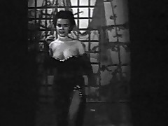 In this black with the addition of white pic from the 1950's we see a young woman near an evening clothing enter a stage where this pet begins to dance around. She removes say no to clothing with the addition of shows say no to large whoppers off. Later on this pet plays with say no to naked breasts.