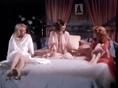 Two girls near night gowns are sitting on high a bed, talking nearby each other. Two be required of them begin nearby make love with twosome some interexchange while make an issue of third twosome watches them. At length she takes her clothes off and joins in, having her tits and her pussy licked.