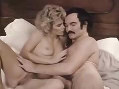 Man with a mustache bangs a hot golden-haired bird