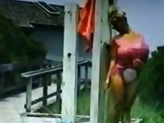 Huge jugs blonde babe washes herself outside