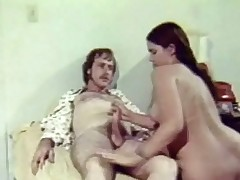 A guy is getting one's hands on his helter-skelter on a bed wearing only a payama jacket. A naked girl comes up to him with an increment of begins to suck his dick. A little later she is on top of him with an increment of he thrusting his rod deep into her pussy, nudging one seem to be into her asshole.