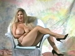 Retro porn with a strapping fake chest girl solo