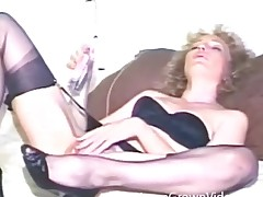 Vintage dildo intercourse scene with curly hair milf